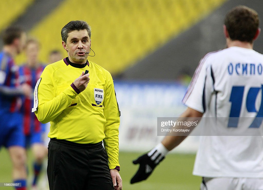 Referee Alexei Nikolayev (L) has a word with Yevgeni Osipov of FC Mordovia Saransk during the Russian Premier League match between PFC CSKA Moscow and FC Mordovia Saransk at the Luzhniki Stadium on December 09, 2012 in Moscow, Russia.