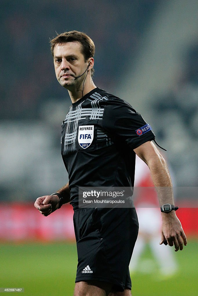 Referee, Alexey Kulbakov in action during the UEFA Europa League Group L match between AZ Alkmaar and Maccabi Haifa FC at the AFAS Stadium on November 28, 2013 in Alkmaar, Netherlands.