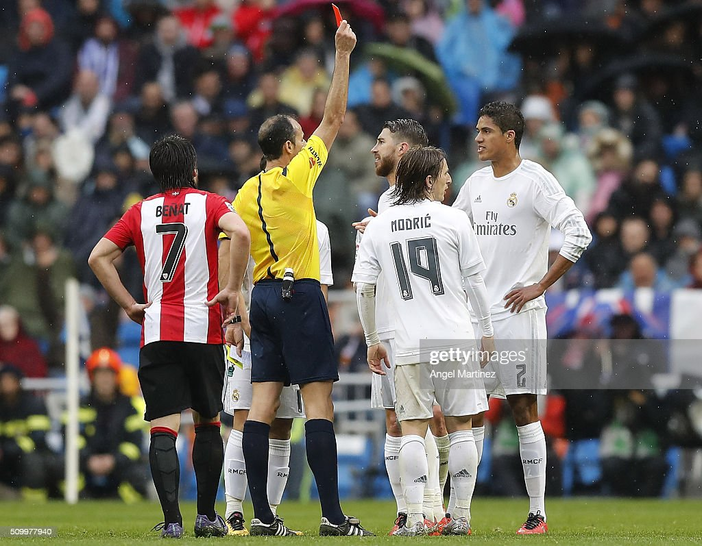 Referee Alfonso Alvarez shows a red card to <a gi-track='captionPersonalityLinkClicked' href=/galleries/search?phrase=Raphael+Varane&family=editorial&specificpeople=7365948 ng-click='$event.stopPropagation()'>Raphael Varane</a> of Real Madrid during the La Liga match between Real Madrid CF and Athletic Club at Estadio Santiago Bernabeu on February 13, 2016 in Madrid, Spain.