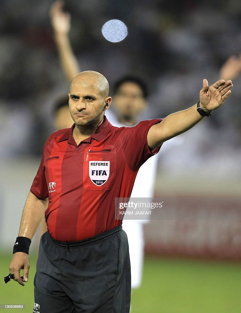 UAE referee Ali Hamad gestures during the match between South Korea's Suwon Samsung Bluewings club against Qatar's Al-Sadd club in their semi-final football match in the AFC Champions League in Doha, on October 26, 2011. Suwon Samsung Bluewings won the match 1-0.