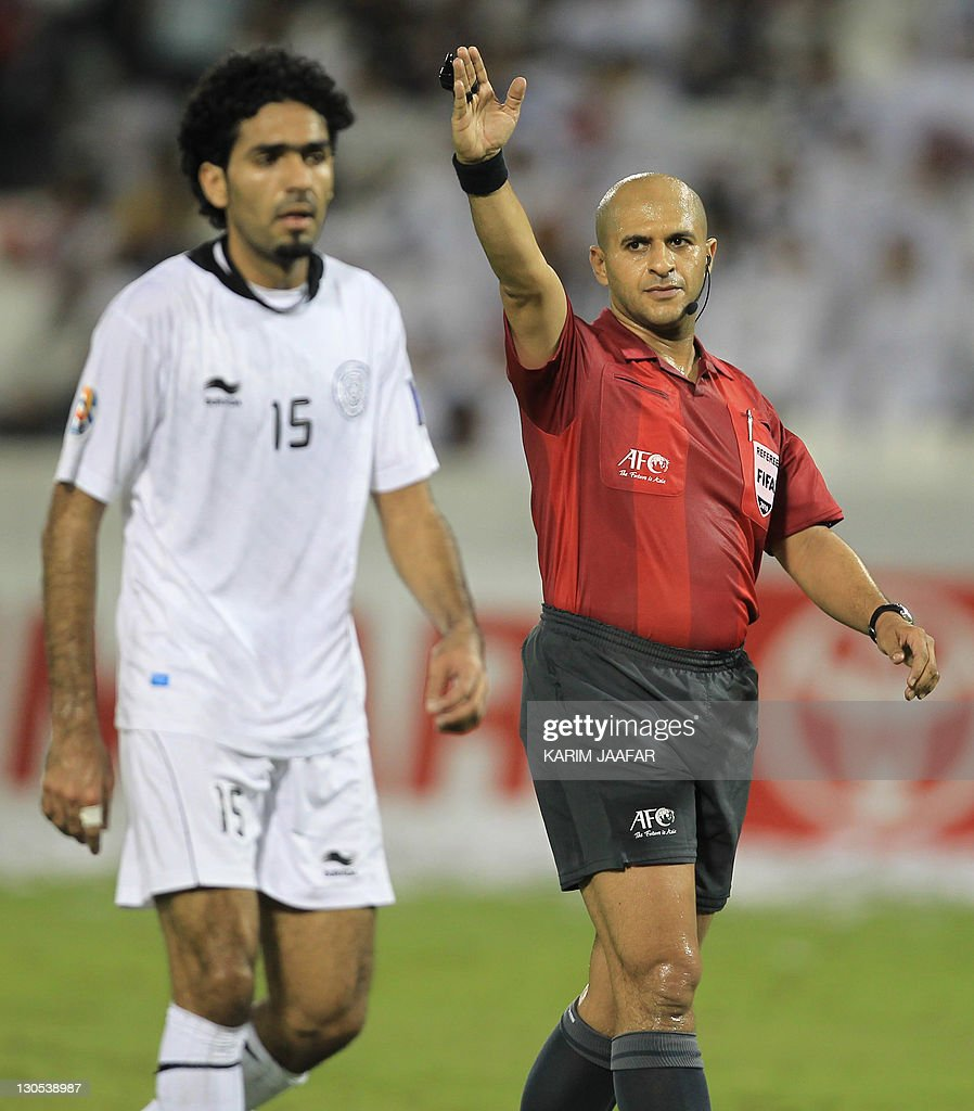 UAE referee Ali Hamad gestures during the match between South Korea's Suwon Samsung Bluewings club against Qatar's Al-Sadd club in their semi-final football match in the AFC Champions League in Doha, on October 26, 2011. Suwon Samsung Bluewings won the match 1-0. AFP PHOTO/KARIM JAAFAR