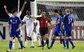 UAE referee Ali Hamad gestures towards players during the match between South Korea's Suwon Samsung Bluewings club against Qatar's AlSadd club in...