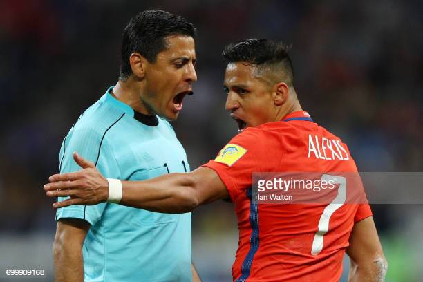 Referee Alireza Faghani argues with Alexis Sanchez of Chile during the FIFA Confederations Cup Russia 2017 Group B match between Germany and Chile at...