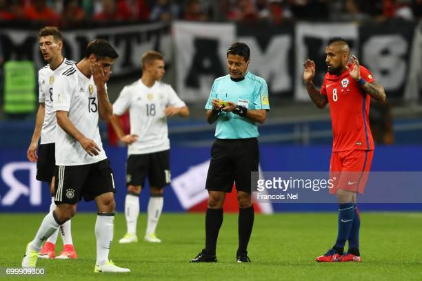 Referee Alireza Faghani argues with Arturo Vidal of Chile during the FIFA Confederations Cup Russia 2017 Group B match between Germany and Chile at...