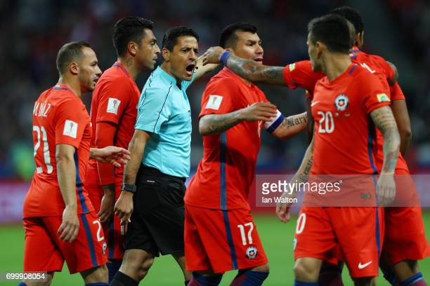 Referee Alireza Faghani attempts to calm the Chile players down during the FIFA Confederations Cup Russia 2017 Group B match between Germany and...