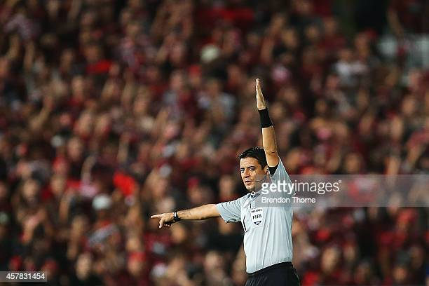 Referee Alireza Faghani gestures during the Asian Champions League final match between the Western Sydney Wanderers and Al Hilal at Pirtek Stadium on...