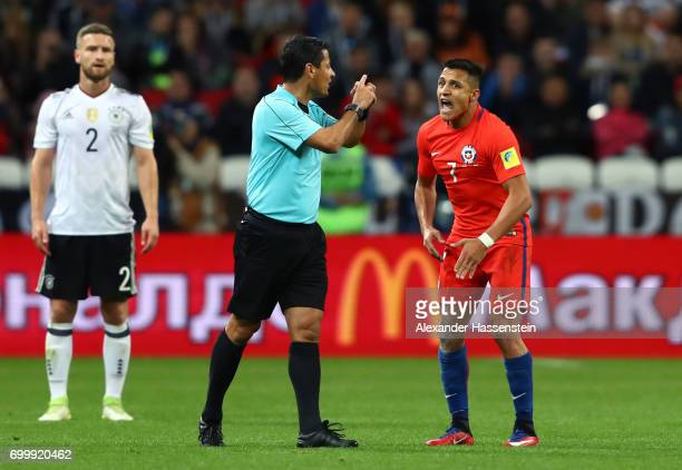 Referee Alireza Faghareacts argues with Alexis Sanchez of Chile during the FIFA Confederations Cup Russia 2017 Group B match between Germany and...