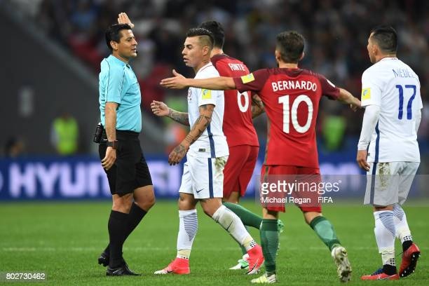 Referee Alireza Faghareacts gestures during the FIFA Confederations Cup Russia 2017 SemiFinal between Portugal and Chile at Kazan Arena on June 28...