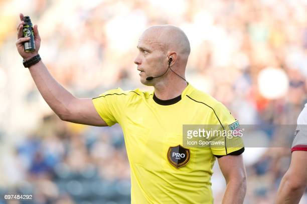 Referee Allen Chapman gestures to players with his line spay in the second half during the game between the New York Red Bulls and Philadelphia Union...