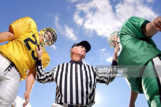 Referee and football players