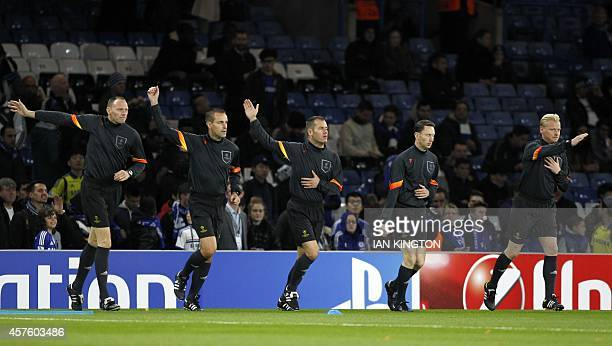Referee and match officials warmup before the UEFA Champions League Group G football match between Chelsea and Maribor at Stamford Bridge in London...