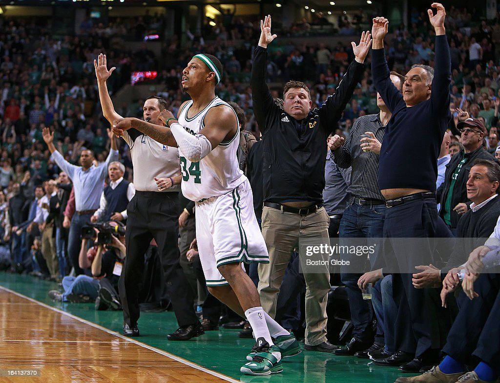 A referee and numerous fans signal that a second quarter three pointer by Celtics captain Paul Pierce (#34) is good, and the shot put Boston ahead 52-38. The Boston Celtics hosted the Miami Heat in a regular season NBA basketball game at the TD Garden.