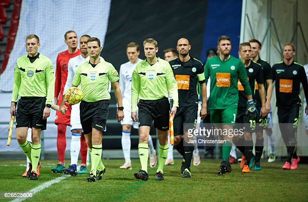 Referee Anders Poulsen and linesmen walk on to the pitch prior to the Danish Alka Superliga match between FC Copenhagen and Viborg FF at Telia Parken...