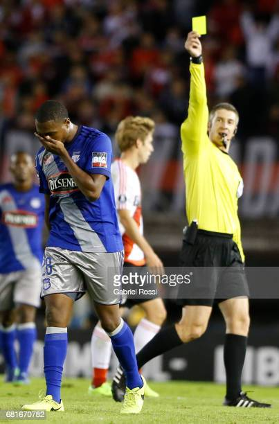 Referee Anderson Daronco shows a yellow card to Jordan Andres Jaime of Emelec during a group stage match between River Plate and Emelec as part of...