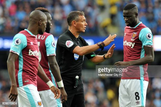 Referee Andre Marriner and West Ham United's Cheikhou Kouyate in action during the Barclay's Premiership match at the Etihad Stadium Manchester on...