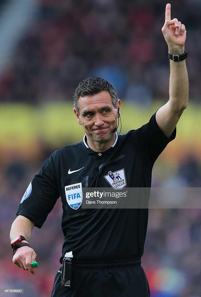 Referee Andre Marriner during the Barclays Premier League match between Stoke City and Crystal Palace at The Britannia Stadium on March 21 2015 in...