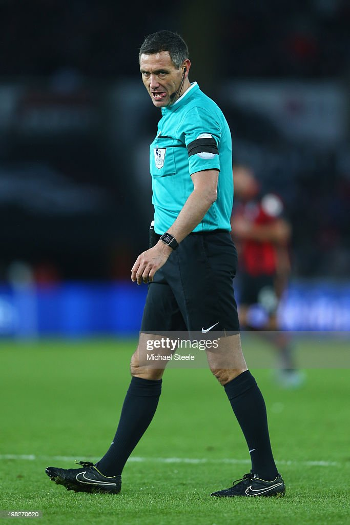 Referee Andre Marriner during the Barclays Premier League match between Swansea City and Bournemouth at the Liberty Stadium on November 21 2015 in...