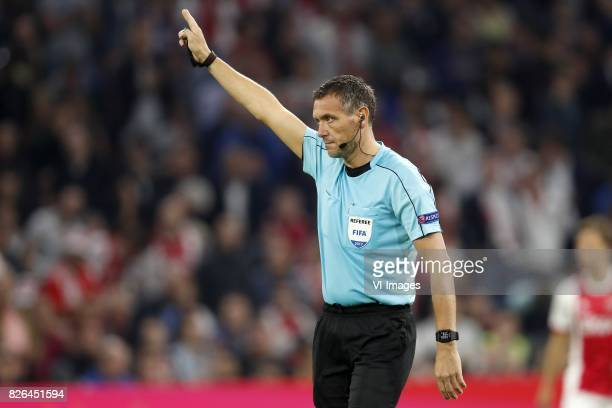 referee Andre Marriner during the UEFA Champions League third round qualifying first leg match between Ajax Amsterdam and OGC Nice at the Amsterdam...