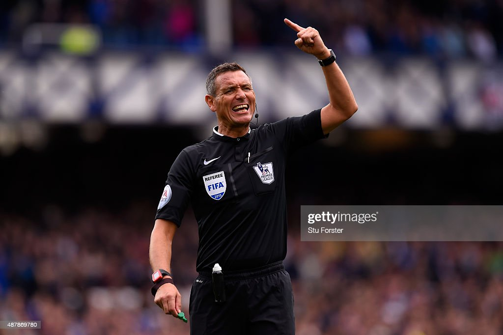 Referee Andre Marriner gestures during the Barclays Premier League match between Everton and Chelsea at Goodison Park on September 12 2015 in...