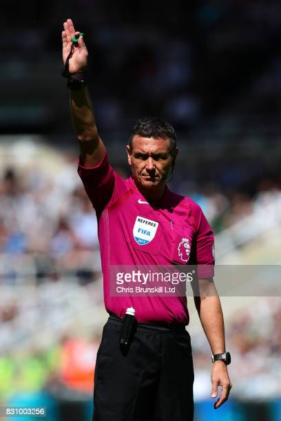 Referee Andre Marriner gestures during the Premier League match between Newcastle United and Tottenham Hotspur at St James' Park on August 13 2017 in...