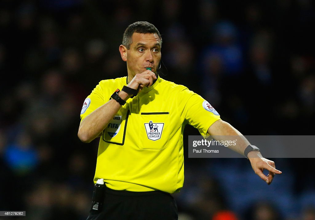 Referee Andre Marriner gives a decision during the Barclays Premier League match between Burnley and Queens Park Rangers at Turf Moor on January 10...
