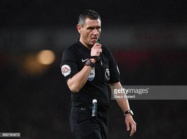 Referee Andre Marriner gives a decision during the Premier League match between Arsenal and Crystal Palace at the Emirates Stadium on January 1 2017...