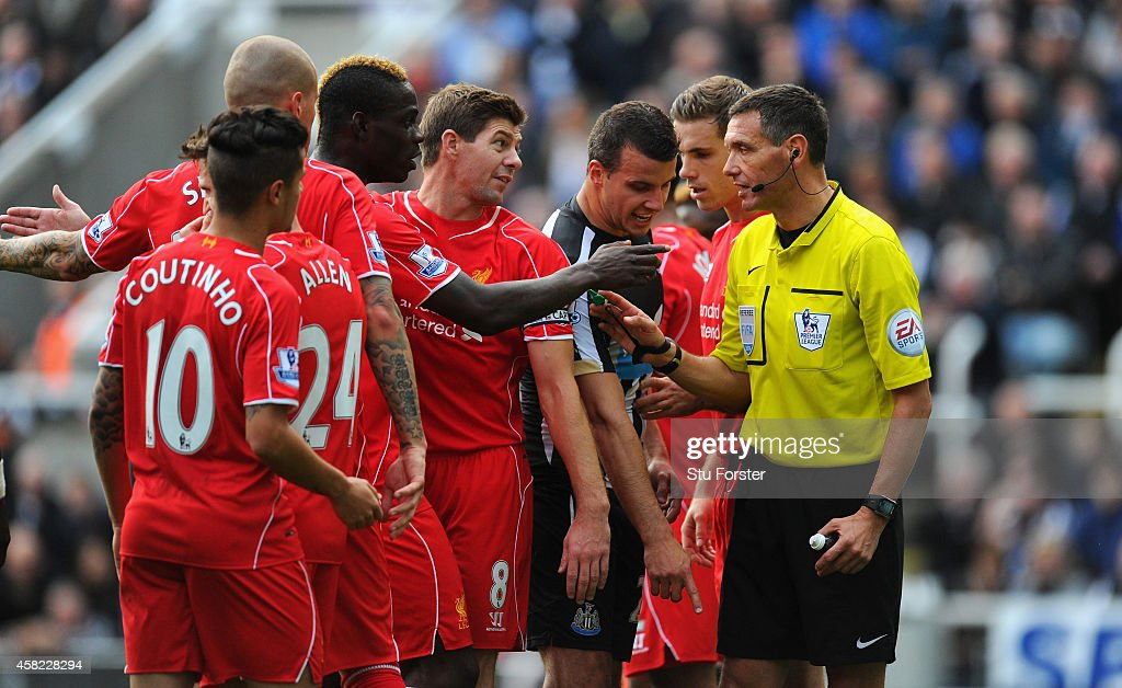 Referee Andre Marriner in action during the Barclays Premier League match between Newcastle United and Liverpool at St James' Park on November 1 2014...