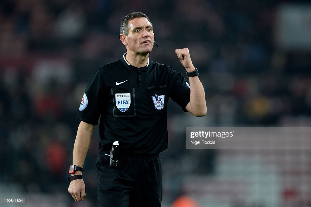 Referee Andre Marriner in action during the Barclays Premier League match between Sunderland and Hull City at the Stadium of Light on December 26...