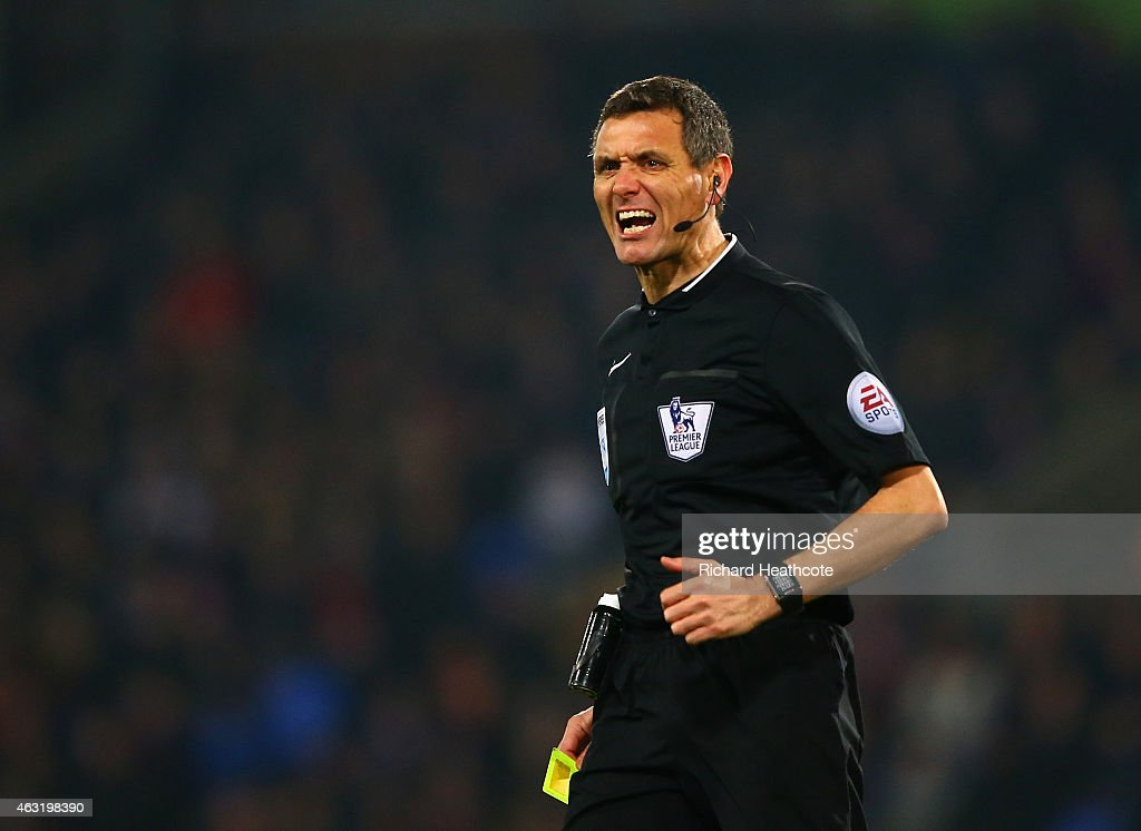 Referee Andre Marriner in action during the Barclays Premier League match between Crystal Palace and Newcastle United at Selhurst Park on February 11...