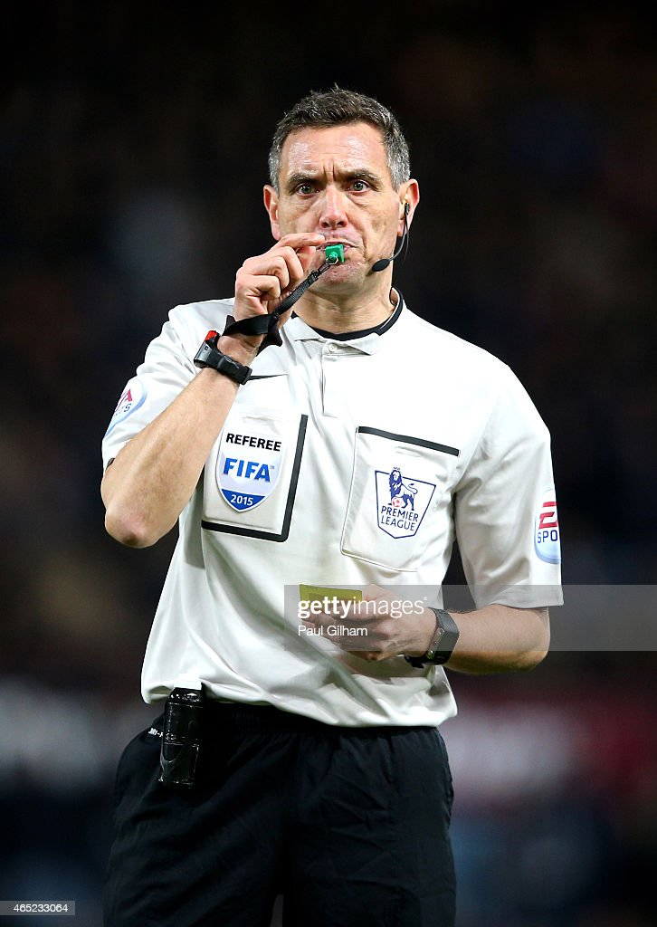 Referee Andre Marriner in action during the Barclays Premier League match between West Ham and Chelsea at the Boleyn Ground on March 4 2015 in London...