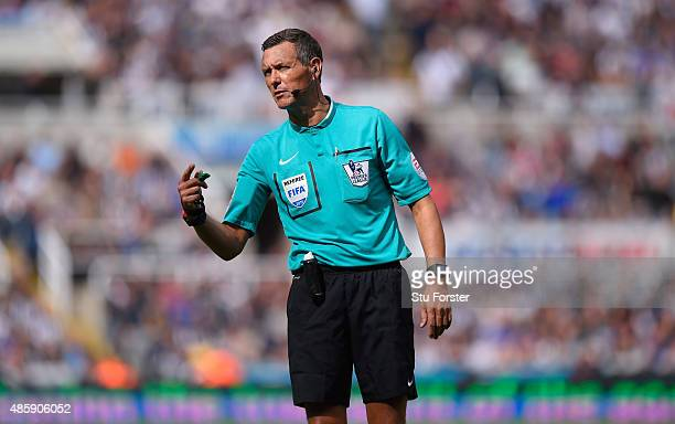 Referee Andre Marriner in action during the Barclays Premier League match between Newcastle United and Arsenal at St James' Park on August 29 2015 in...
