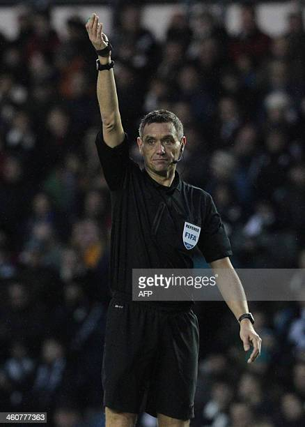 Referee Andre Marriner in action during the English FA Cup third round football match between Derby County and Chelsea at the iPro Stadium in Derby...