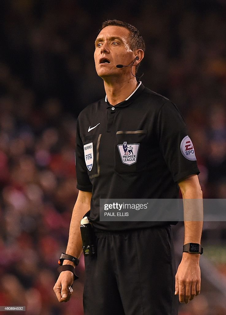 Referee Andre Marriner looks on during the English Premier League football match between Liverpool and Swansea City at Anfield in Liverpool north...