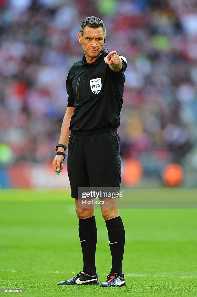 Referee Andre Marriner looks on during the FA Cup with Budweiser semifinal match between Hull City and Sheffield United at Wembley Stadium on April...