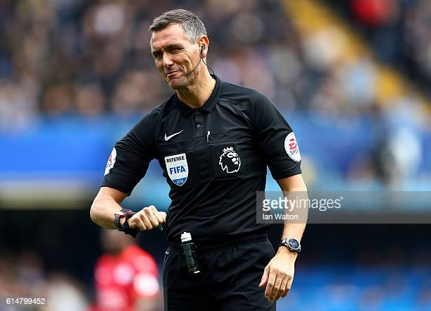 Referee Andre Marriner looks on during the Premier League match between Chelsea and Leicester City at Stamford Bridge on October 15 2016 in London...