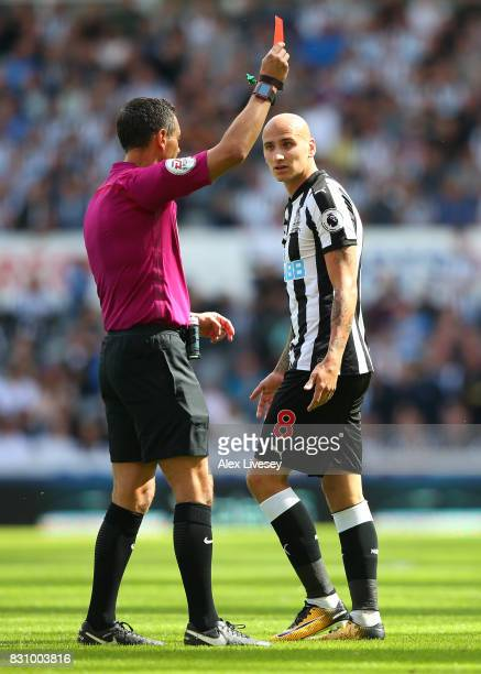 Referee Andre Marriner shows a red card to Jonjo Shelvey of Newcastle United during the Premier League match between Newcastle United and Tottenham...