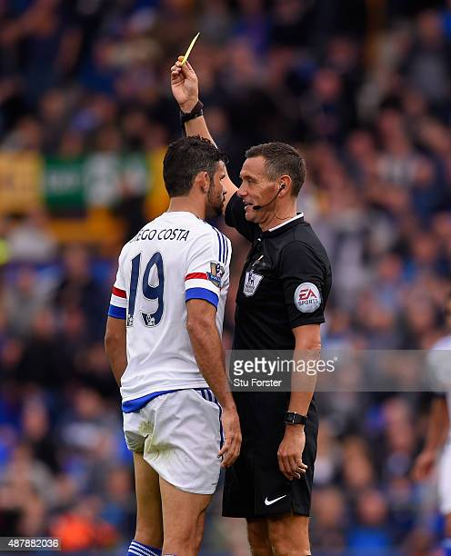 Referee Andre Marriner shows the yellow card to Diego Costa of Chelsea during the Barclays Premier League match between Everton and Chelsea at...