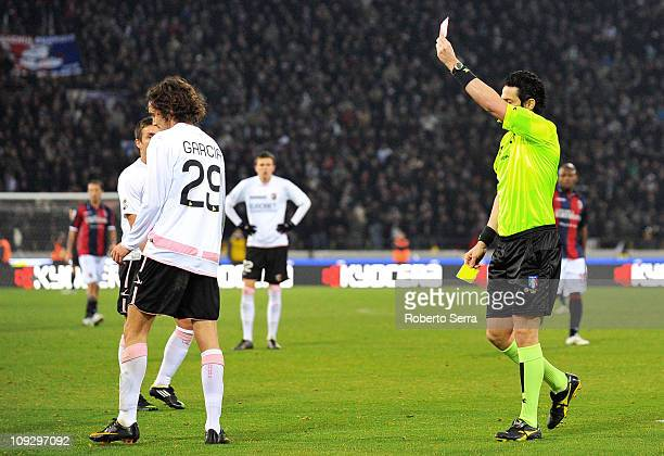 Referee Andrea De Marco shows a red card to Santiago Garcia during the Serie A match between Bologna and Palermo at Stadio Renato Dall'Ara on...