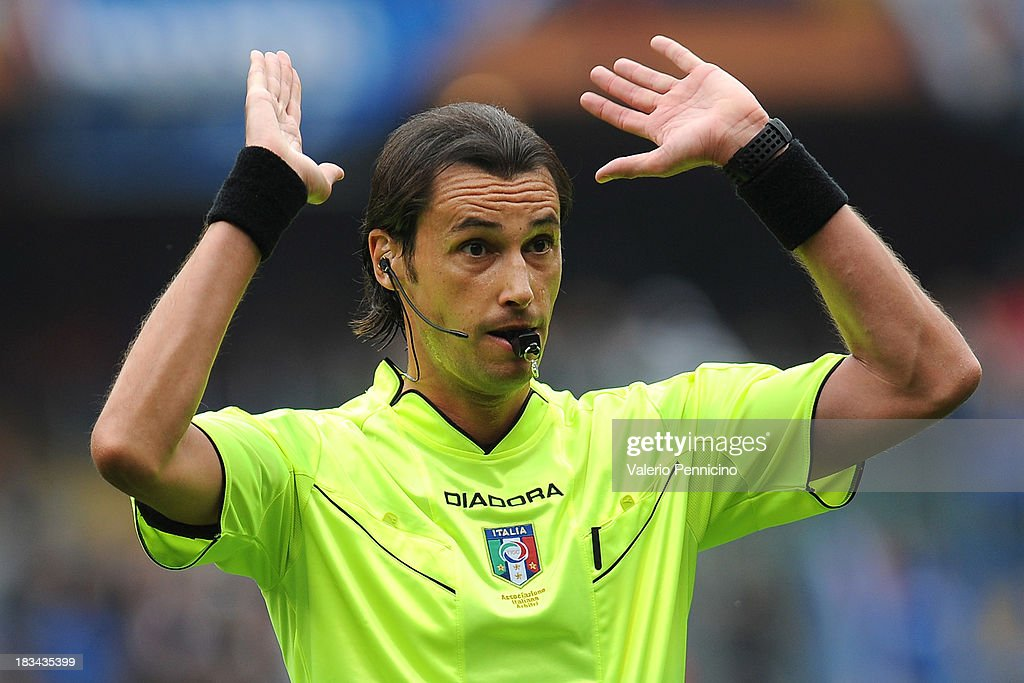 Referee Andrea Gervasoni gestures during the Serie A match between UC Sampdoria and Torino FC at Stadio Luigi Ferraris on October 6, 2013 in Genoa, Italy.