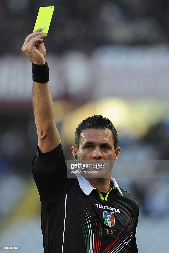 Referee Andrea Romeo shows the yellow card during the Serie A match between Torino FC and AC Milan at Stadio Olimpico di Torino on December 9, 2012 in Turin, Italy.