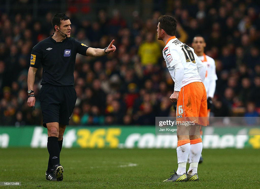 Referee, Andrew Madley has words with Barry Ferguson of Blackpool during the npower Championship match between Watford and Blackpool at Vicarage Road on March 9, 2013 in Watford, England.