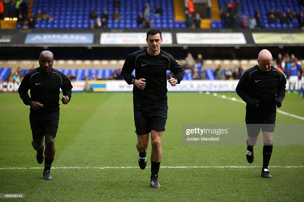 Referee Andrew Madley warms up with Assistant Referee's Dave Bushell and John Magill during the Sky Bet Championship match between Ipswich Town and...