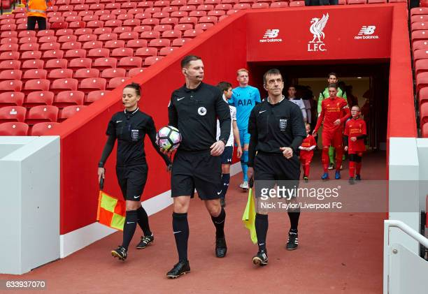Referee Andrew Miller and assistants Rebecca Welch and Paul Brown lead the captains Harry Wilson of Liverpool and Filip Lesniak of Tottenham Hotspur...