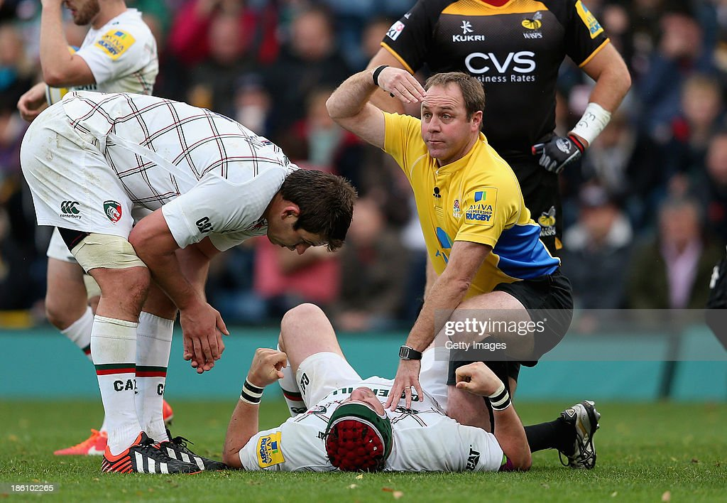 Referee Andrew Small calls for a stretcher for injured Marcos Ayerza of Leicester Tigers during the Aviva Premiership match between London Wasps and Leicester Tigers at Adams Park on October 27, 2013 in High Wycombe, England.