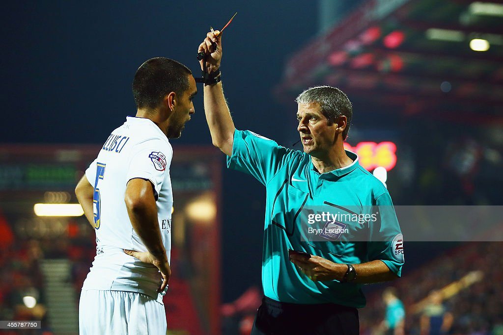 Referee Andy D'Urso shows Giuseppe Bellusci of Leeds Unietd a yellow card during the Sky Bet Championship match between AFC Bournemouth and Leeds United at Goldsands Stadium on September 16, 2014 in Bournemouth, England.