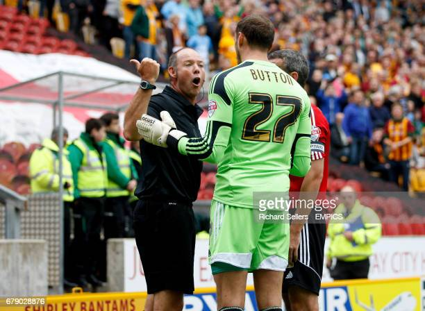 Referee Andy Haines sends off Brentford goalkeeper David Button for serious foul play