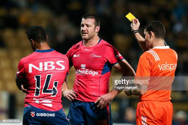 Referee Angus Maybe shows Viliami Lolohea of Tasman a second yellow card before giving a red card while Alex Ainley looks on during the round seven...