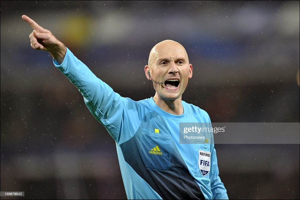 Referee Anthony Gautier signals during the UEFA Champions League Group C match between RSC Anderlecht and FC Zenit St Petersburg at the Constant Vanden Stock Stadium on November 6, 2012 in Brussels, Belgium.