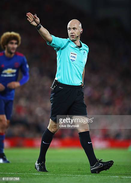 Referee Anthony Taylor signals during the Premier League match between Liverpool and Manchester United at Anfield on October 17 2016 in Liverpool...
