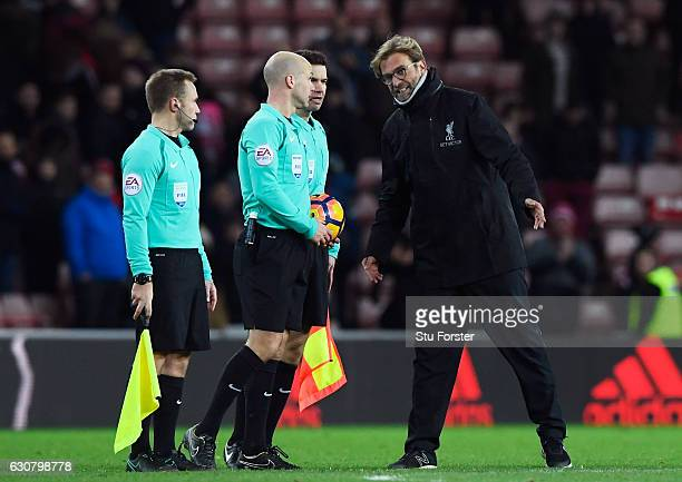 Referee Anthony Taylor speaks to Jurgen Klopp Manager of Liverpool after the Premier League match between Sunderland and Liverpool at Stadium of...